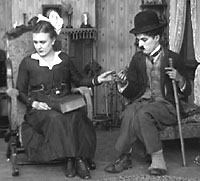 Edna Purviance and Charlie Chaplin in Sunnyside