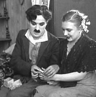 Charlie Chaplin and Edna Purviance in Sunnyside