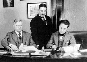 Sydney Chaplin and Charlie Chaplin at the Mutual signing